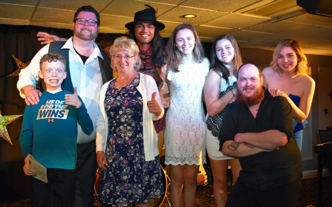Calvin Edwards, from front left, and Juanita King give the Summerside Feast Dinner Theatre cast two thumbs up.